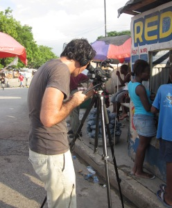 Ross Velton filming in a tented camp in Port-au-Prince